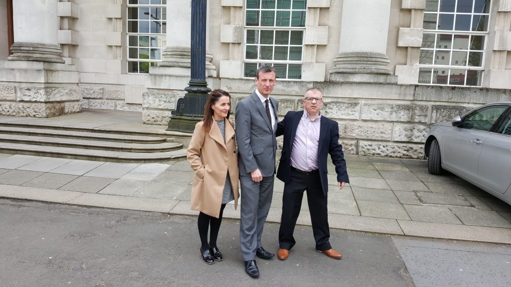 Betty and Stan Jnr outside the court with their solicitor, Paul Pearse, after the hearing concluded